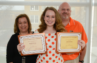 Rebecca Erwin, one of the winners of the John H. Walker Journalism Scholarship, poses with her parents. The award is a tribute to a 1949 journalism graduate.