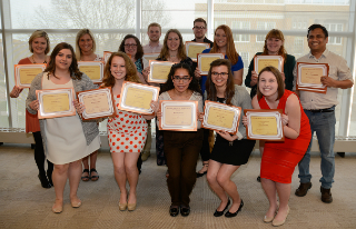 Student award winners pose with their award certificates.