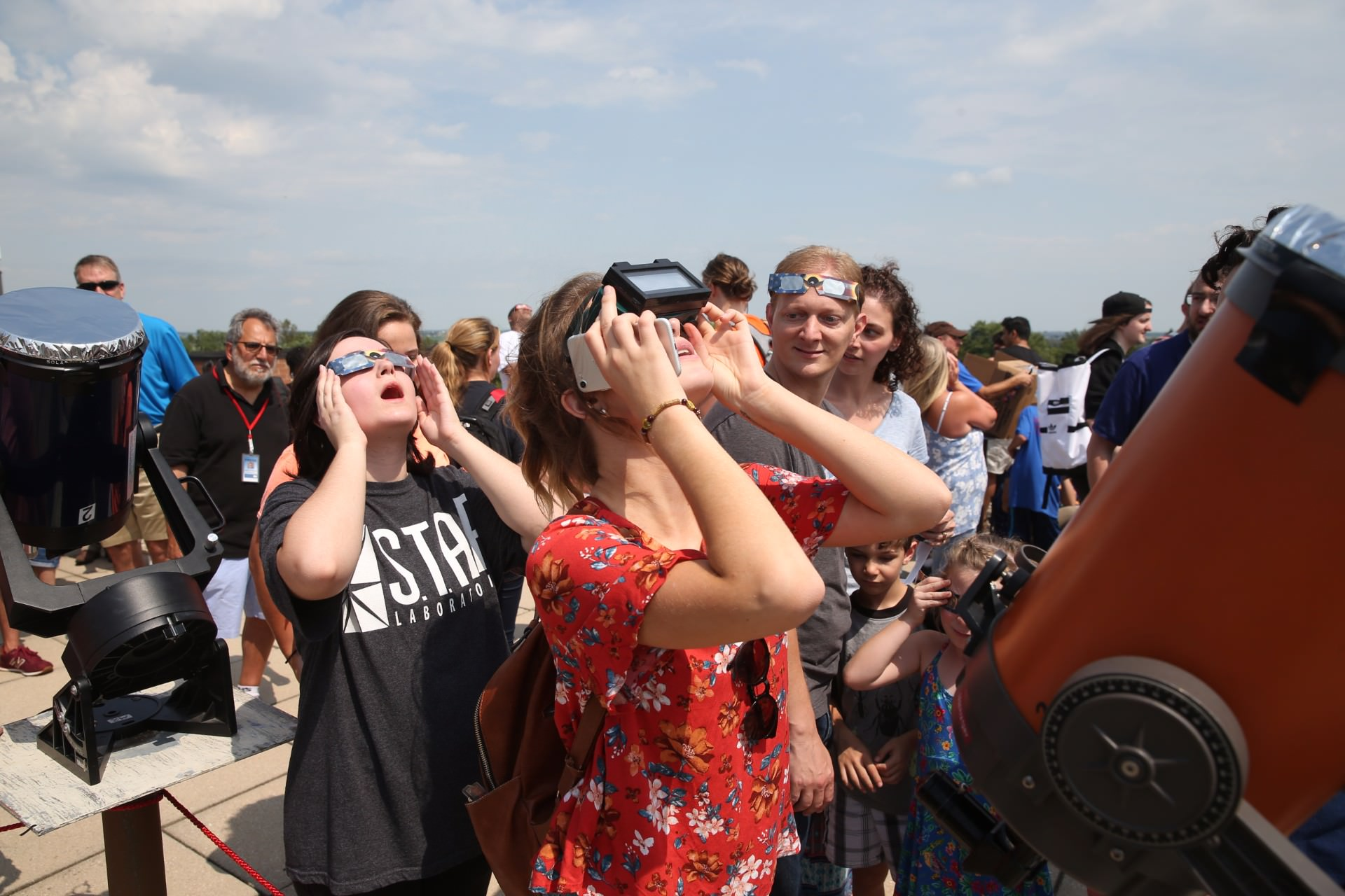 two girls looking at solar eclipse