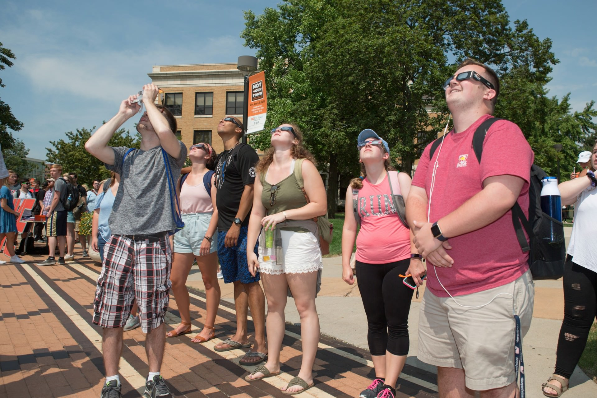 Group of students looking up at solar eclipse