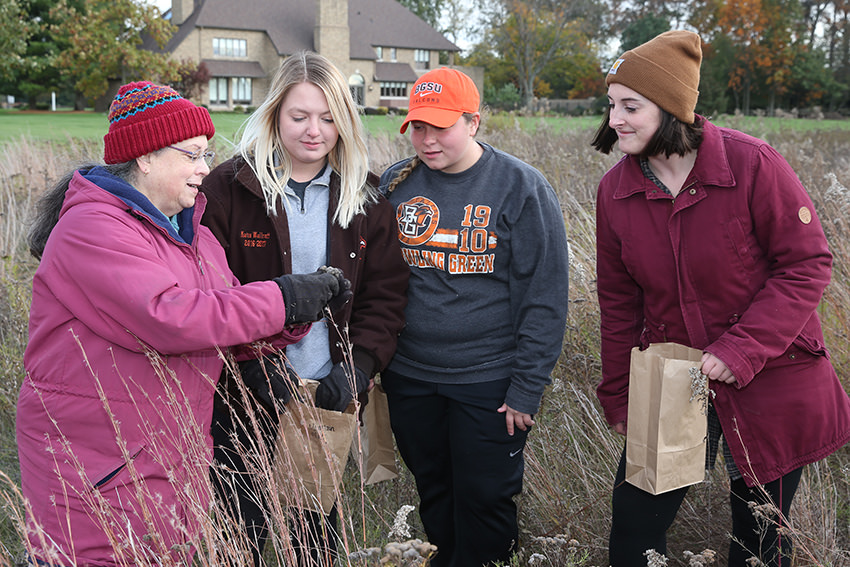 Helen Michaels with Restoration Ecology students (left to right) Katie Wallroff, Kaari DeMarco and Hayley Barrett at the University House