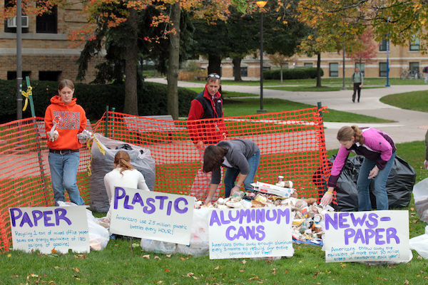 Students conduct an audit of trash produced on campus during last year's Earth Day events.