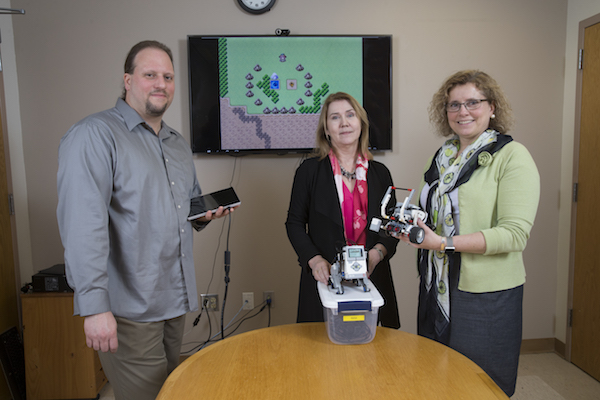 Dr. Eric Mandell (left) and Jadwiga Carlson (right) with grant administrator Dr. Moira van Staaden