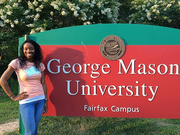 LaShawna Stegall in front of George Mason University Fairfax Campus sign