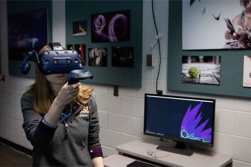 photo of a student working in the AR/VR lab