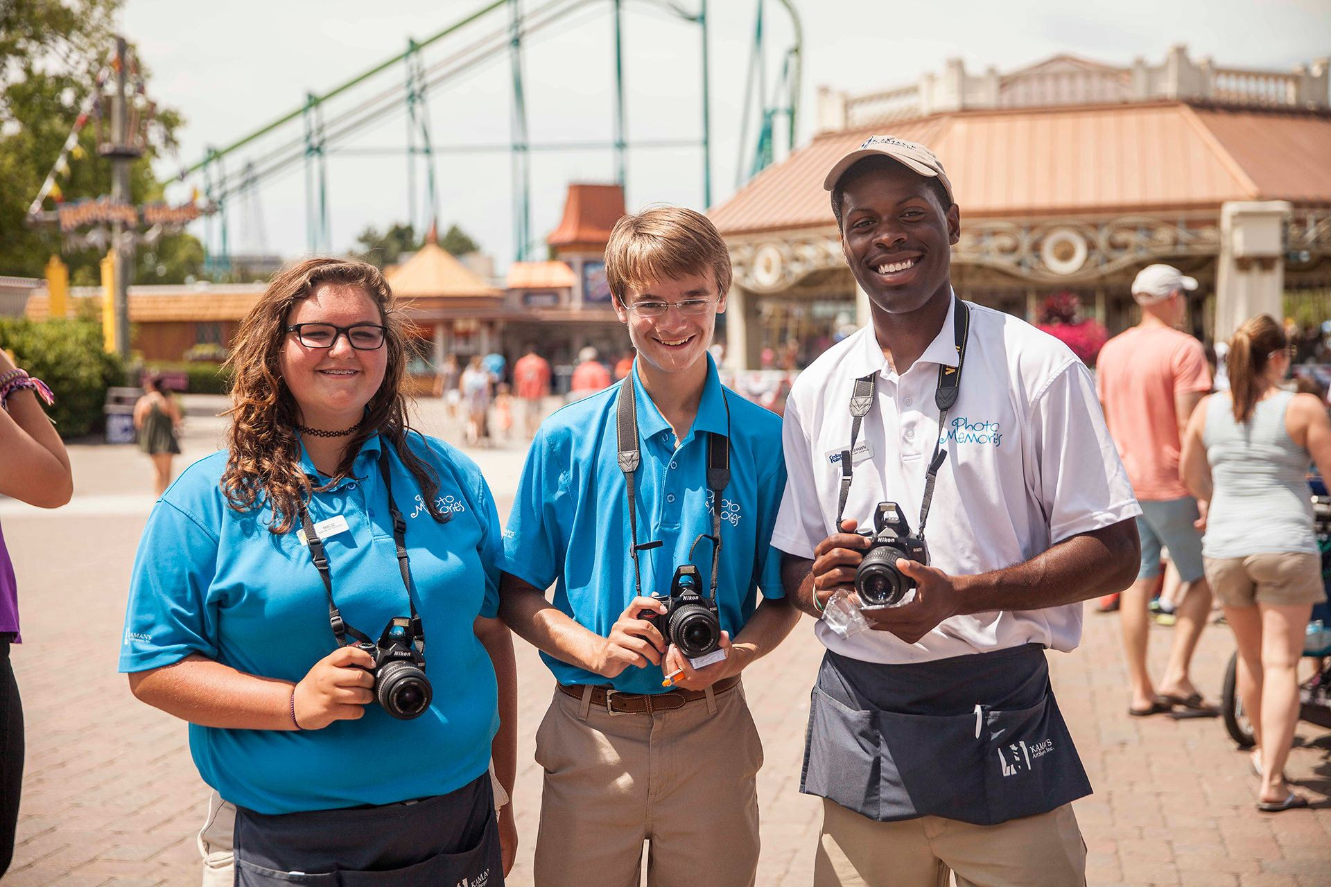 Students holding cameras at cedar point