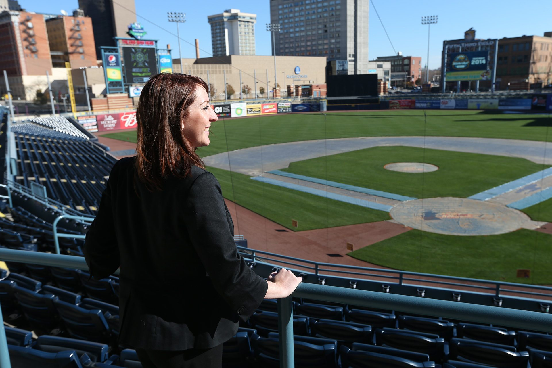 a sport manager overlooking the field.