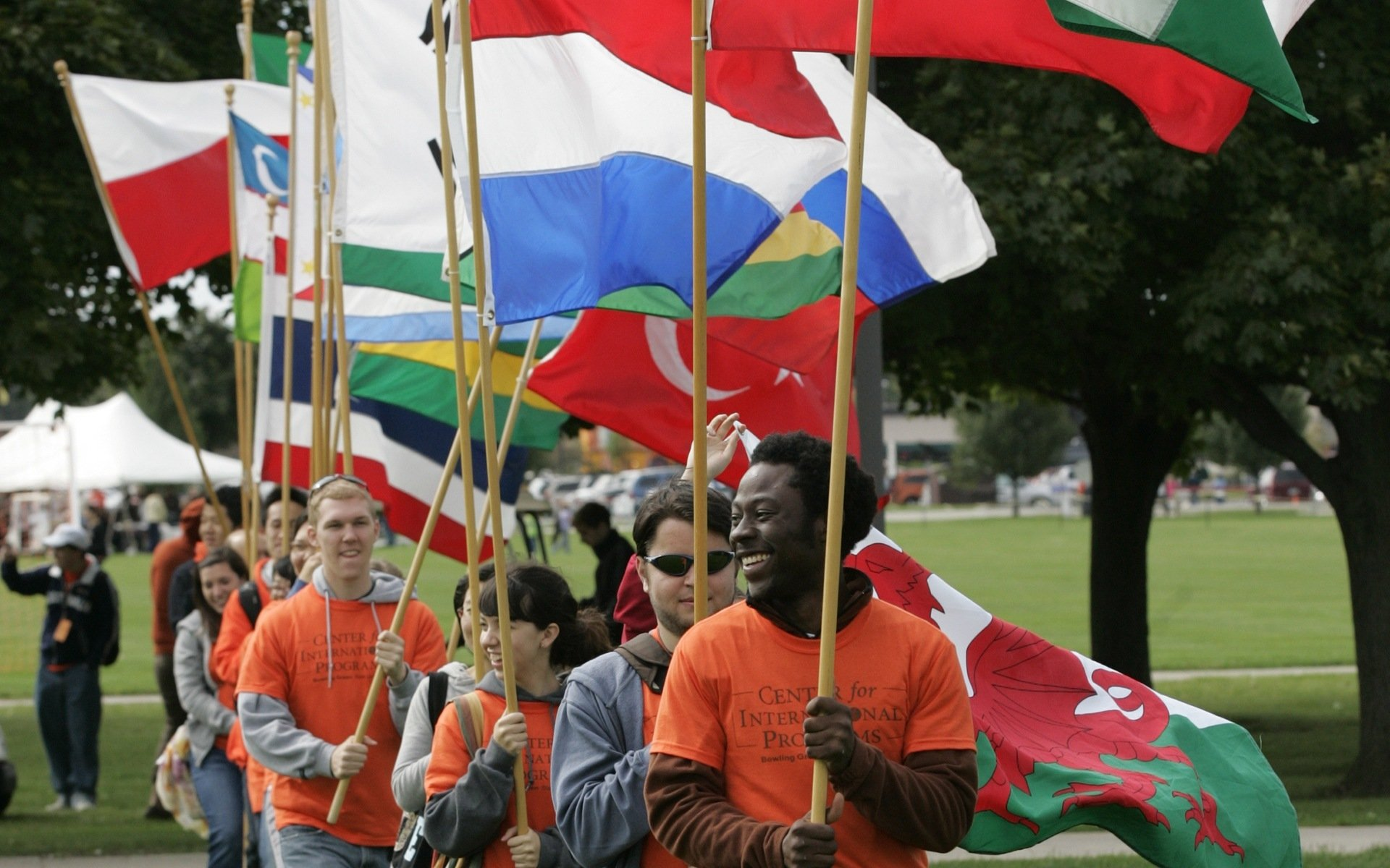 students carrying flags