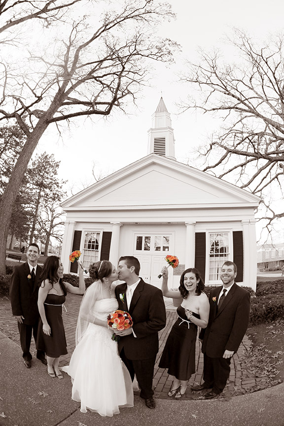 Mary Kay (Coulter) Inkrott '05, '06 and Andy Inkrott '06 share a kiss in front of Prout Chapel on their wedding day, November 14, 2009. The couple met at a football game at the Doyt in 2004