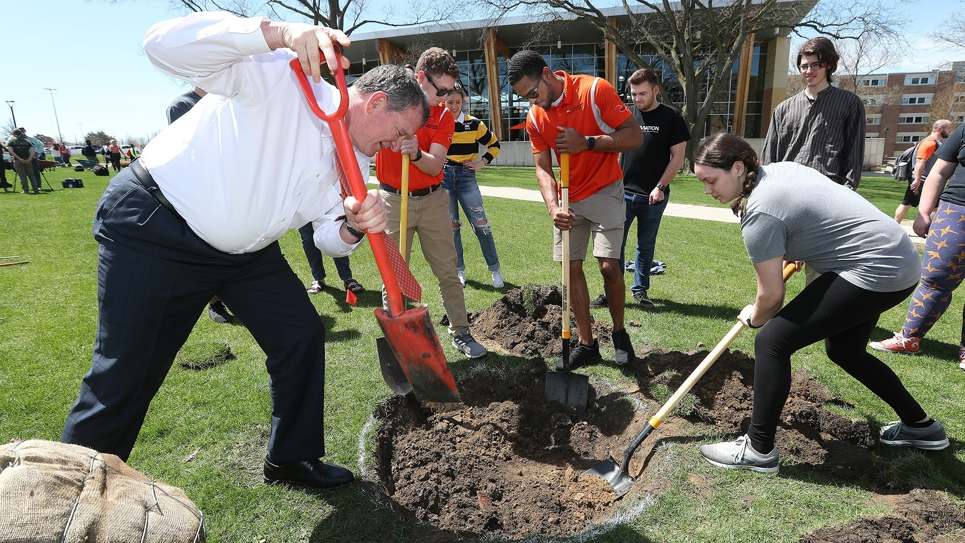 president-rogers-digging-a-hole-with-students
