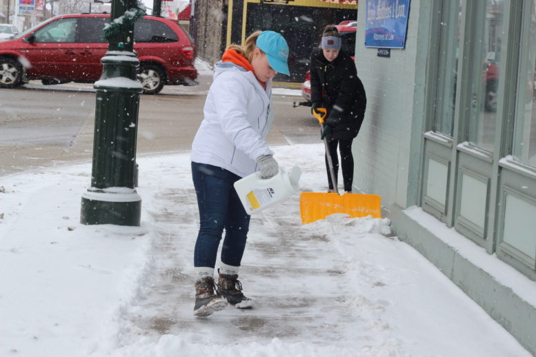 This is a photo of a woman shoveling snow