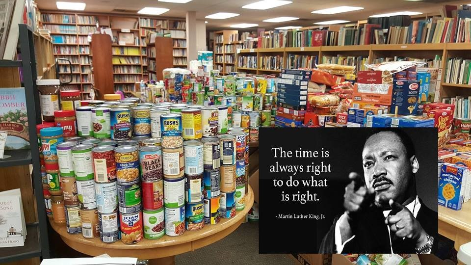 "Image of piled up cans with a quote, ""The time is always right to do what is right"" by Martin Luther King, Jr."