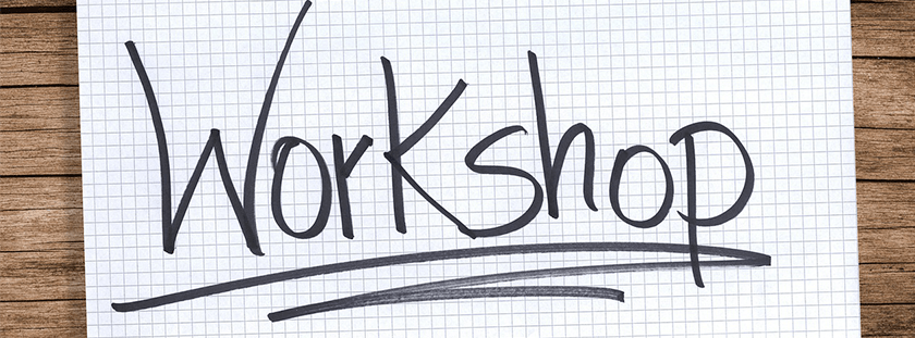 The word workshop handwritten on graph paper