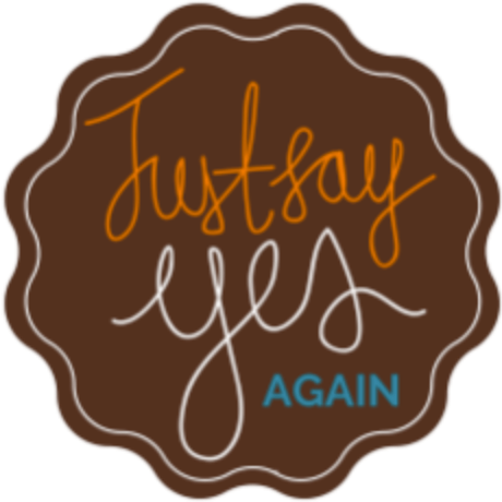 brown circular shape with colorful text that states, Just Say Yes Again