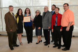 Members of Terry Goodman's family with Courtney Brown, winner of the Terry Goodman Memorial Journalism Scholarship.