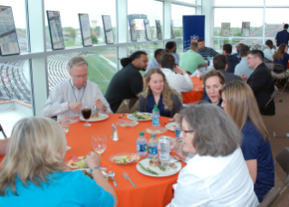 Faculty and graduate students at the welcome dinner in BGSU's Sebo Athletic Center.