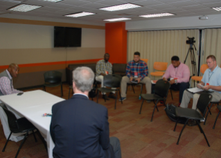 Bucky Brooks of NFL.com and Malcolm Moran help boot camp participants prepare for a mock press conference with BGSU football Head Coach Dino Babers.