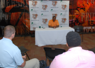 Coach Babers begins the mock press conference for Boot Camp participants.