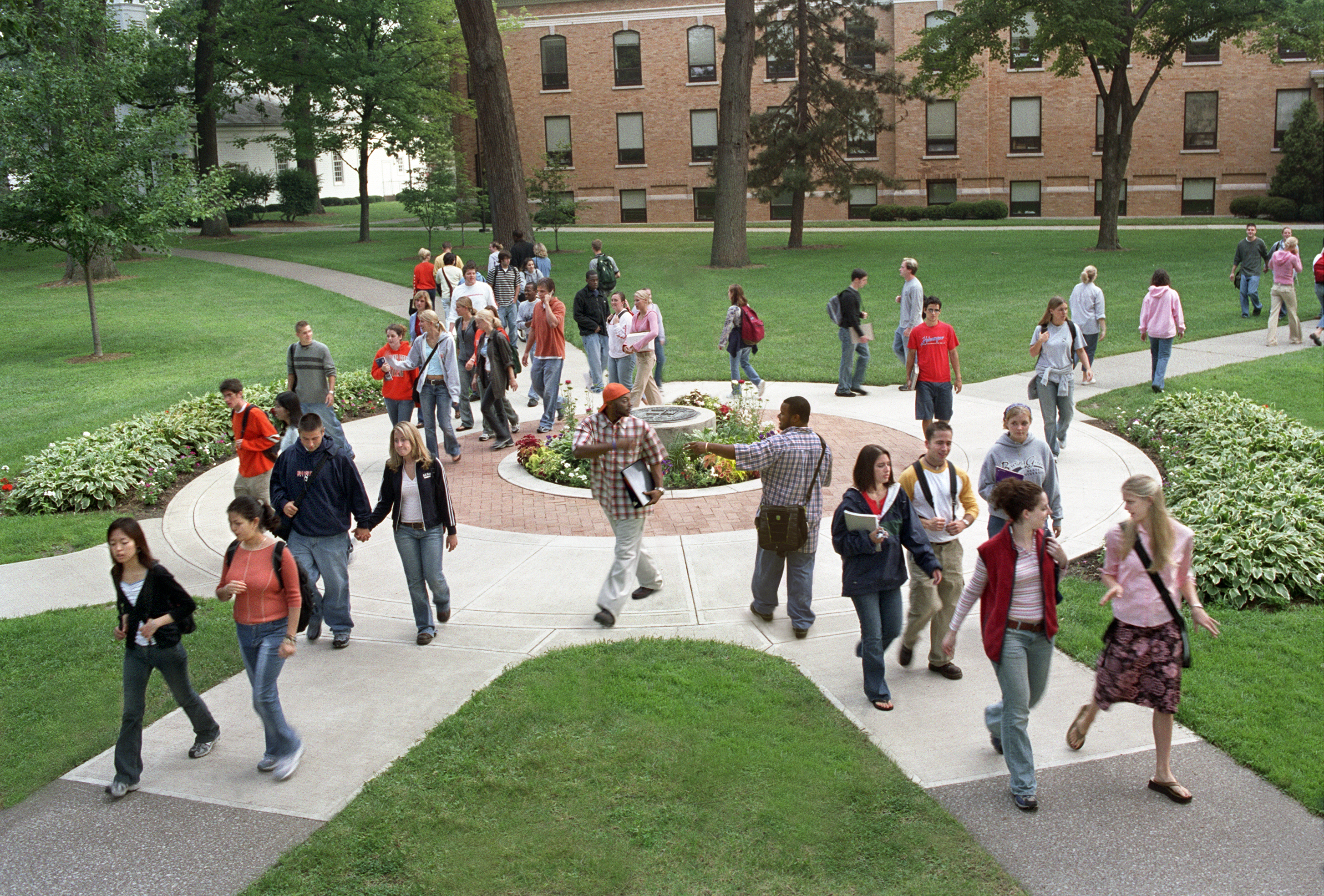 Photo of a group of students walking around the BGSU Seal