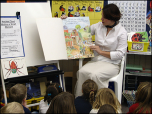 graduate reading to kids image