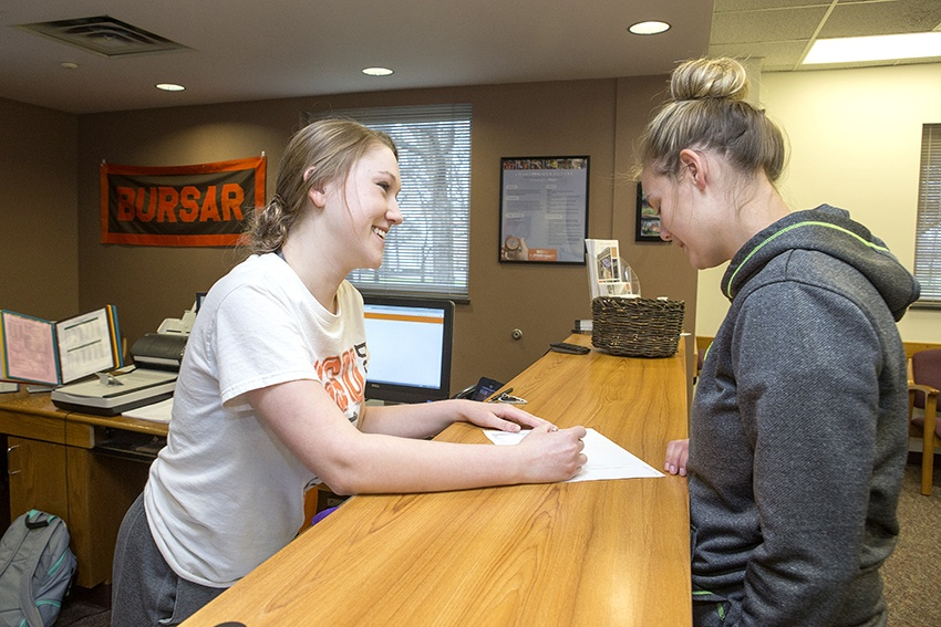 Student getting help from the office of financial aid