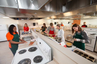 Faculty member Dawn Anderson and students utilize the new Food Science Lab in the College of Health and Human Services.
