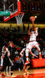 Junior Ismail Ali charges the basket during Falcon basketball at the Stroh Center.
