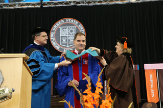 Dr. Thomas Snitch receives an honorary degree May 9 during the Commencement ceremony for the Colleges of Arts and Sciences and Firelands, where he also served as Commencement speaker.