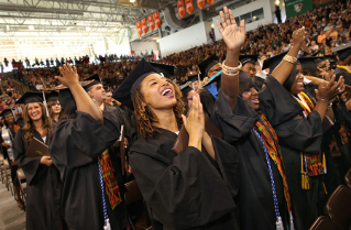 BGSU students celebrate May Commencement at the Stroh Center.