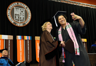 A selfie with President Mary Ellen Mazey at Commencement.
