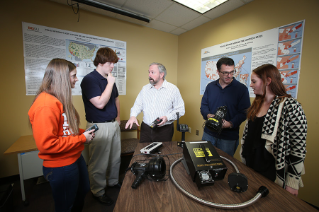 Dr. Steve Lab, professor and director of the Criminal Justice Program (center), and John Liederbach, associate professor of Criminal Justice, examine equipment donated by the Ohio Bureau of Criminal Investigation (BCI) as they prepare students for successful careers with a 480-hour internship requirement that's double what most programs require.