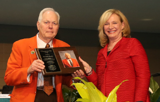 Kermit Stroh, who earned an honorary doctorate from Bowling Green State University in 2002 and was named a BGSU honorary alumnus in 2003, was honored with a Champion of Life award at the Mayor's Luncheon Tuesday prior to the GoDaddy Bowl.