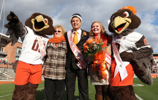 President Mary Ellen Mazey with Homecoming King Austin Flores and Queen Maren Legg.