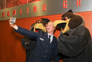 A selfie with Freddie and Frieda Falcon following commencement ceremonies.