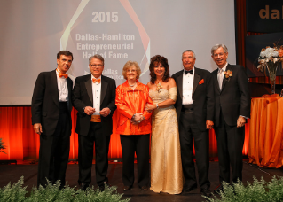 The 2015 inductees into the Dallas-Hamilton Entrepreneurial Hall of Fame celebrate with Ray Braun, dean of the College of Business Administration, and President Mary Ellen Mazey (second and third from left). Shown  left to right are Drew Forhan '81, Kathy Hunt '84, Richard Kappel '69,  and Eugene Novak '74.  The hall inducts BGSU graduates or honorary degree holders who have achieved excellence in entrepreneurship and have demonstrated an entrepreneurial spirit that inspires others.