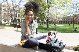 A spring day brings students outside of the Bowen-Thompson Student Union to study.