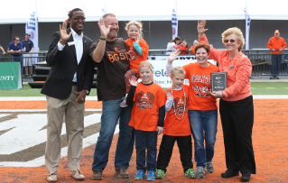 Melanie Yarger, her husband Curt, and children Hannah, 9, Nicholas, 8, and Natalie, 5 were chosen as the 2015 Falcon Family of the Year. The honor was presented to them at the Sept. 19 home football game, during Falcon Family Weekend by President Mary Ellen Mazey, right, and Sidney Childs, Interim Vice President for Student Affairs,left.