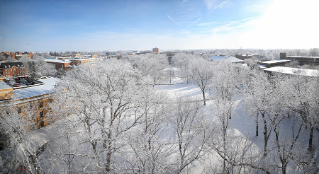 A birds-eye view of a wintry campus scene.