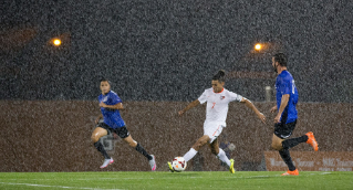 Senior Ryan James battles for a win in the torrential downpour at Cochrane Field. A total of eight Bowling Green State University men's soccer student-athletes were named to the Academic All-Mid-American Conference Team.