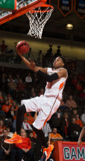 Former Bowling Green State University men's basketball standout Richaun Holmes was selected at pick No. 37 by the Philadelphia 76ers in the 2015 National Basketball Association (NBA) Draft. During his senior season at BGSU in 2014-15, Holmes was tabbed the MAC Defensive Player of the Year, earned a spot on the All-MAC First-Team and was named a 2014-15 NABC District 14 All-District First-Team selection. The 6-10 forward led the Falcons in scoring (14.7), rebounding (8.0), blocks (2.7) and minutes (28.8) per game, as well as in field goal percentage at 56.3 percent shooting on the year.