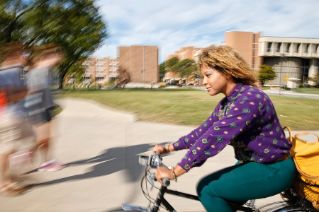 Senior Marjorie Williams bikes across campus between business classes.