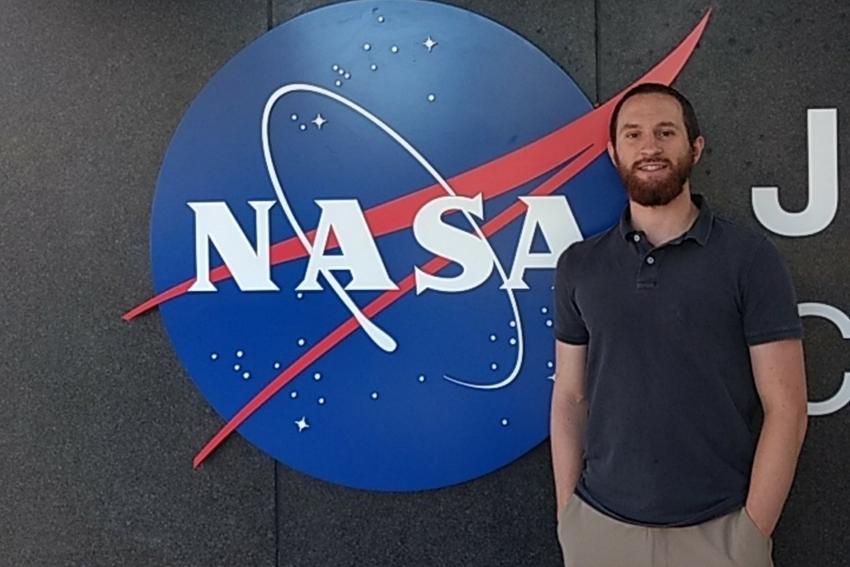 Student Andrew Watkins studies planet's six-year signal at NASA