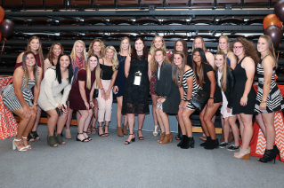 Inductee Liz (Vrabel) Knoblauch '06 with current members of the Falcon Softball team