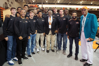 Hall of Famers Chuck McCampbell '59 and Crystal Ellis '57, '75, '93 with current Men's Basketball team members