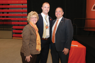 Inductee Nolan Reimold with Mary Ellen Mazey, Ph.D., President of BGSU, and Bob Moosbrugger '94, Director of Athletics