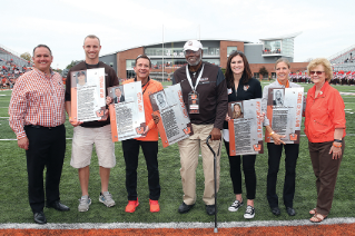 2017 Hall of Fame inductees during on-field recognition at the Northern Illinois football game, with President Mazey and Bob Moosbrugger '94