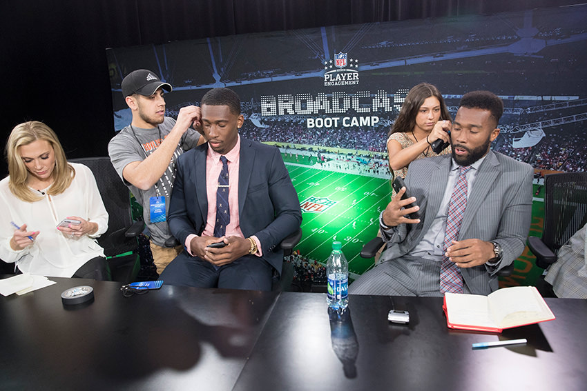 Students-working-with-NFL-players-at-broadcast-boot-camp