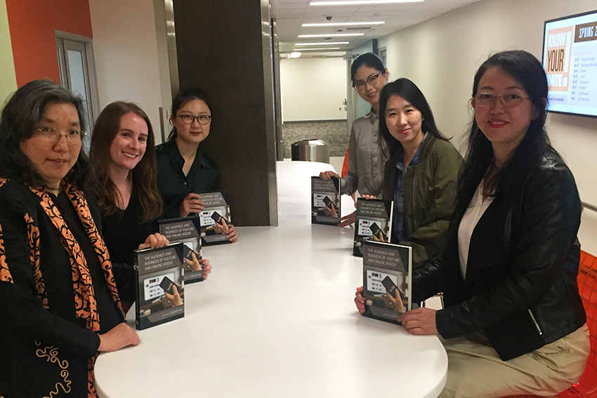 Dr. Louisa Ha and students write book