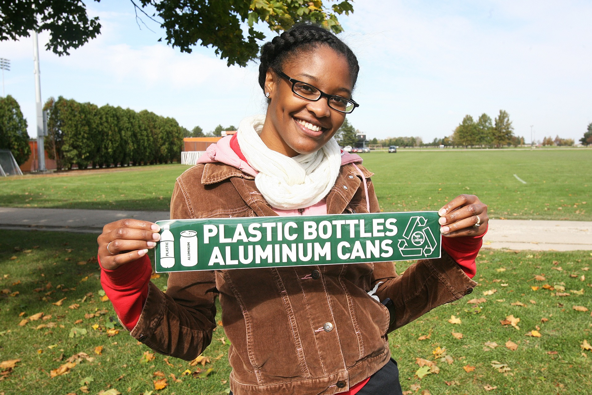 Student holding recycling sign