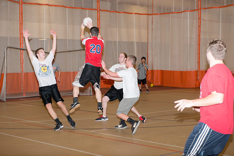 Students playing intramural handball